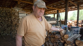 Richard explains the difference between the types of wood stored at his woodshed.